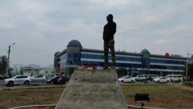 "Photo of Namadingo Acts as ""statue"" to fundraise money"